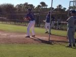 Coach Pratt works with his pitcher.